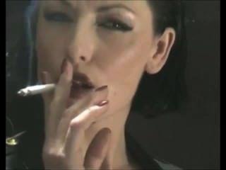 مدمن لذيذ التدخين الكلبة مدرب صنم في بولي كلوريد الفينيل اللاتكس